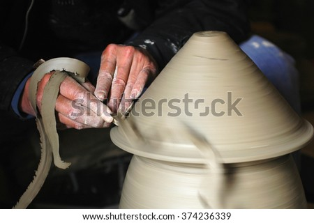Making a porcelain vase with clay