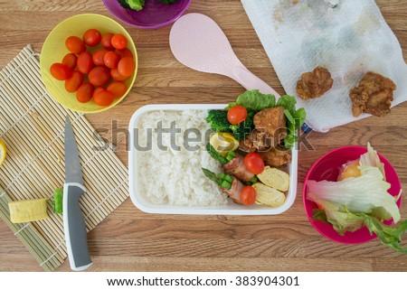 making bento, japanese style lunch box - stock photo