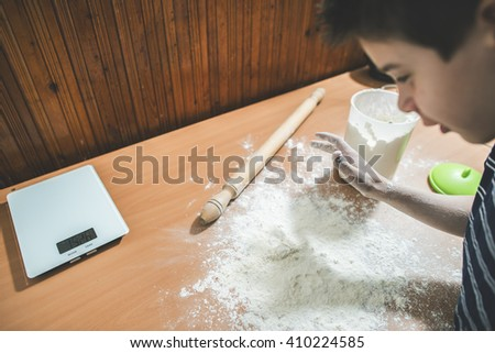 Making bread in a kitchen. Child make bread. Balls of dough - stock photo