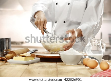 making cake in kitchen