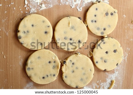 Making Chocolate Chip Cookies. Series. Rounds of raw cookies. - stock photo