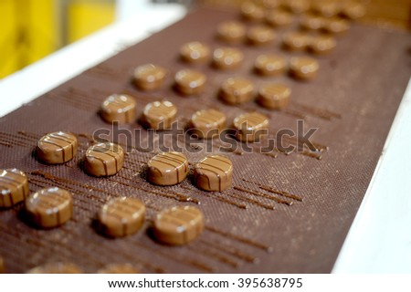 Making chocolate in the chocolate factory - stock photo