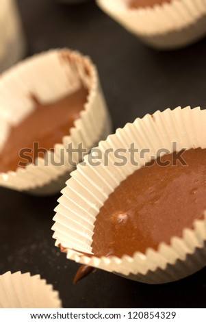 making chocolate tartlets - stock photo