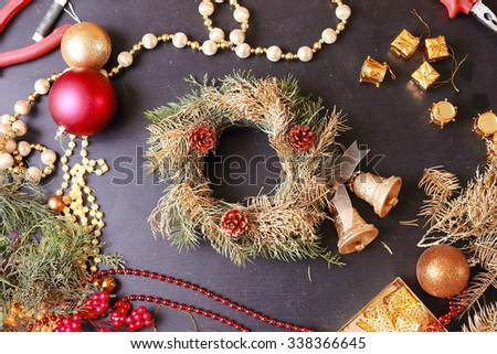 Making christmas advent wreath. Tools and decorations. - stock photo