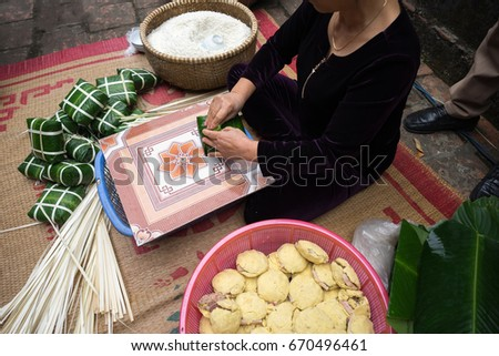 Making Chung cake by female craftsman closeup. Traditional Vietnamese New Year (Tet) food.