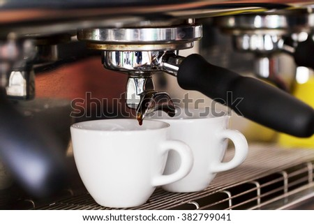 Making coffee in the coffee machine. Morning atmospheric lighting, fashionable trendy spot soft focus. Preparation for design creative menu.