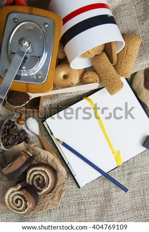 Making coffee set with manual coffee grinder. coffee beans, sweets cookie. space for text. toned image, soft focus