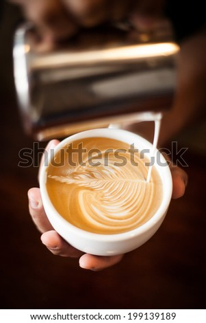 making coffee  with latte art - stock photo