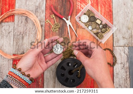 making craft jewellery on wood background  - stock photo