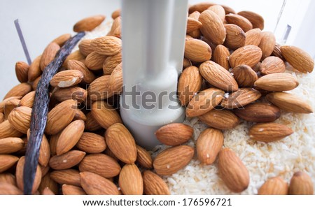 Making delicious almond coconut butter in food processor - stock photo
