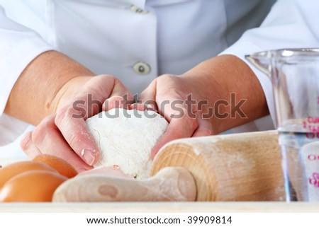 making dough for delicious baked good, narrow focus. - stock photo