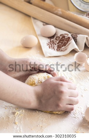 Making dough for fresh egg pasta. Kneading dough. See series - stock photo