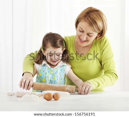Making dough together - stock photo