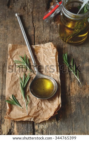 Making fragrant rosemary oil with olive oil and fresh herbs