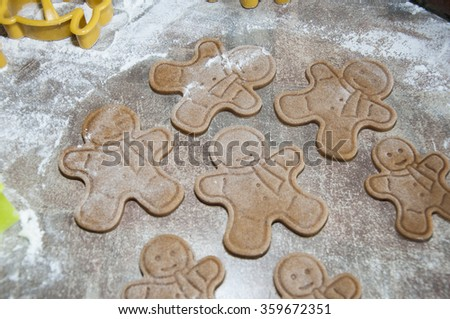 Making gingerbread cookies for Christmas. Gingerbread dough with snowflake shapes.Christmas baking background: dough, cookie cutters and spices. Viewed from above. - stock photo