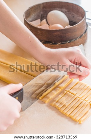 Making home egg pasta tagliatelle. see series - stock photo