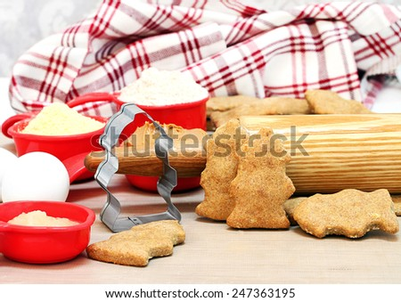 Making homemade peanut butter dog biscuits shaped like fire hydrants. Rolling pin and ingredients