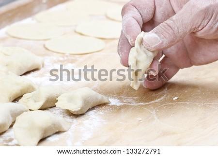 Making homemade polish dumplings - stock photo