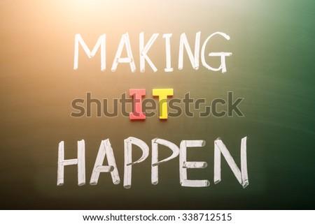 Making hope happen concept words on blackboard - stock photo