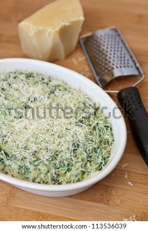 Making Hot Spinach Dip - stock photo