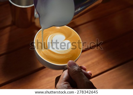 Making of cafe latte art, heart shape - stock photo