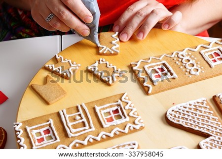 Making of christmas gingerbread house.  Chimney decorating.