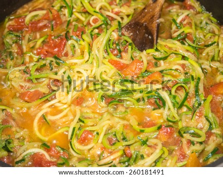 Making of spiral zucchini spaghetti imitation noodles. - stock photo
