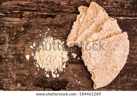 making pita bread on a wood background - stock photo