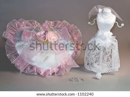 Making plans for a wedding with dress and rings. - stock photo