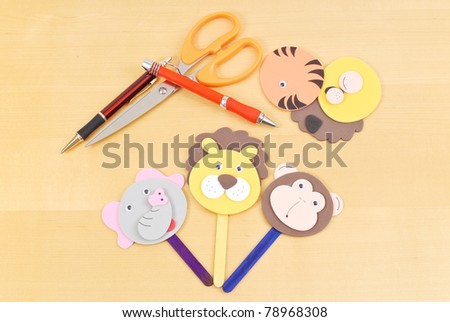 Making Popsicle Puppets - stock photo
