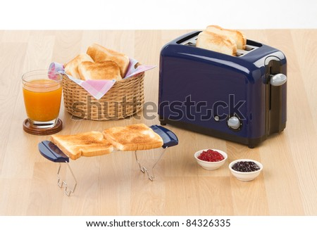 Making sandwich by bread toaster a useful kitchenware - stock photo