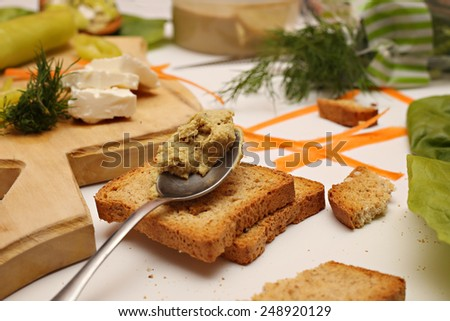 Making sandwiches, Making vegetarian sandwiches with toast and hummus - stock photo