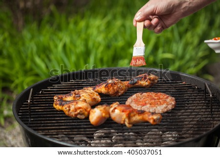 Making spicy chicken wings and burgers. - stock photo