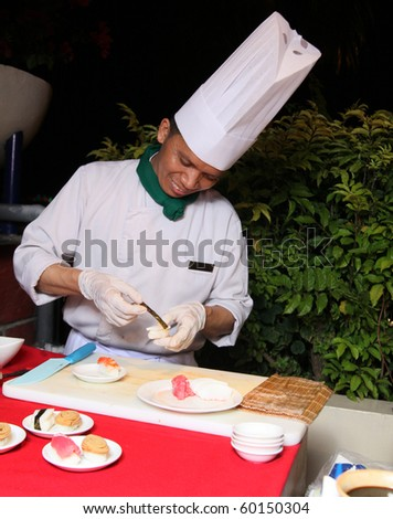 Making sushi buffet at dinner barbecue - stock photo