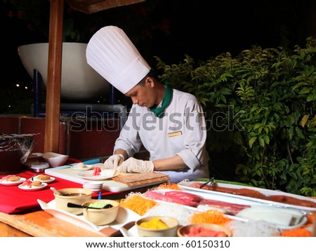 Making sushi buffet at dinner barbecue