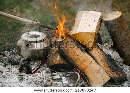 Making tea or coffee in the campfire on nature - stock photo