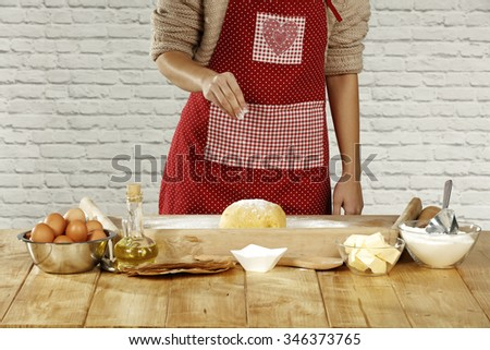 making the dough and red woman
