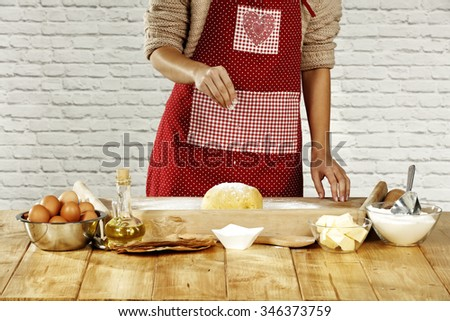 making the dough and woman