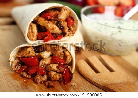 Making Tortilla with chicken and bell pepper. Series. - stock photo