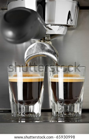 Making two cups of espresso - stock photo