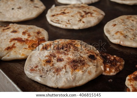 making typical delicious flour tortillas from guatemala and El Salvador, pupuseria, pupusa - stock photo