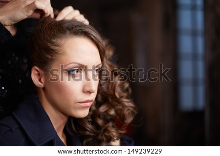 Making-up actress before shooting musical clip - stock photo