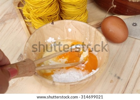 Making yellow noodle with egg and wheat flour