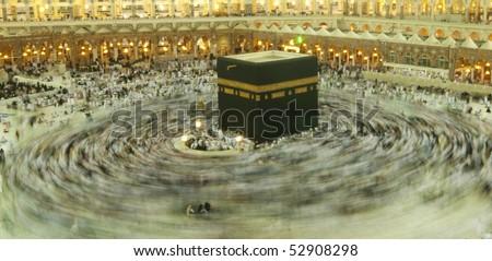 MAKKAH - APRIL 23 : A 5-second exposures of pilgrims circumabulate (tawaf) Kaaba on April 23, 2010 in Makkah, Saudi Arabia. Pilgrims circumambulate the Kaaba seven times in counterclockwise direction. - stock photo