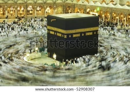 MAKKAH - APRIL 24 : A 6-second exposures of pilgrims circumabulate (tawaf) Kaaba on April 24, 2010 in Makkah, Saudi Arabia. Pilgrims circumambulate the Kaaba seven times in counterclockwise direction. - stock photo