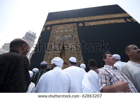 MAKKAH - APRIL 26 : Close up of kaaba with pilgrims circumambulate the Kaaba at Masjidil Haram on April 26, 2010 in Makkah, Saudi Arabia. Muslims all around the world face the Kaaba during prayer time - stock photo