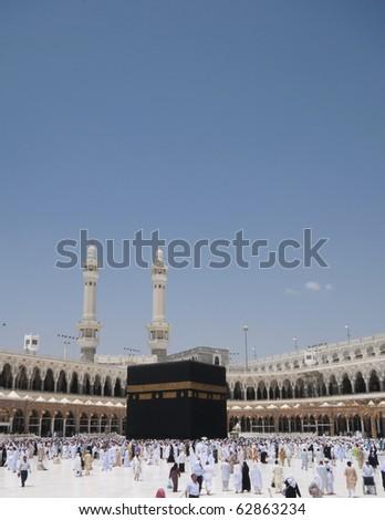 MAKKAH - APRIL 27 : Pilgrims circumambulate the Kaaba at Masjidil Haram on April 27, 2010 in Makkah, Saudi Arabia. Muslims all around the world face the Kaaba during prayer time. - stock photo