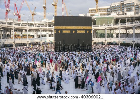 MAKKAH - DECEMBER 22 2014: Pilgrims circumambulate the Kaaba at Masjidil Haram  in Makkah, Saudi Arabia. Muslims all around the world face the Kaaba during prayer time. - stock photo