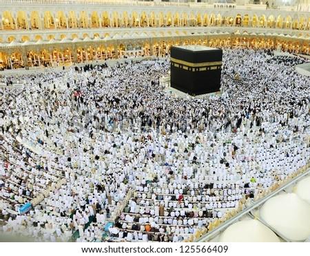 MAKKAH - JULY 21 : A crowd of pilgrims circumabulate (tawaf) Kaaba on July 21, 2012 in Makkah, Saudi Arabia. Pilgrims circumambulate the Kaaba seven times in counterclockwise direction. - stock photo