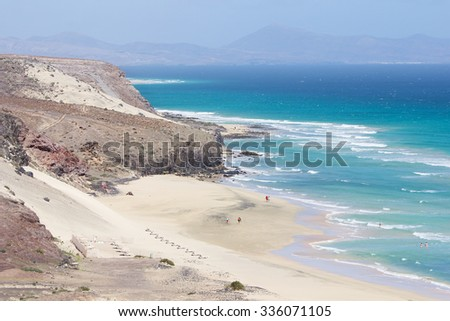 Mal Nombre beach or Playa del Mal Nombre on a windy day, with its golden sand, situated on the south east coast of the island of Fuerteventura, Canary Islands, Spain.